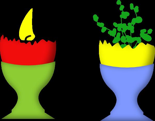 Kerze und Pflanze in Ostereischale